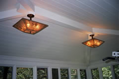 Rectangular mica ceiling lights with custom hand-cut bird and leaf designs.