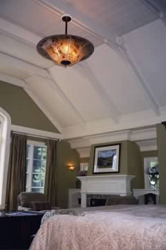 Mica ceiling and wall lighting in the master bedroom with custom hand-cut designs.