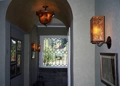 Custom lighting in the entry with natural leaves echo the custom tile floor.