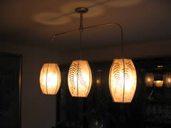 Mica hanging lamps grace the dining room