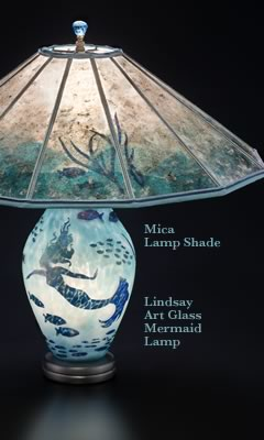 Lighted lamp base in this Lindsay Art Glass Mermaid Table Lamp + Mica lamp shade with tropical fish and seaweed